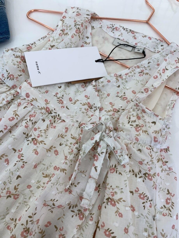 Shop Online Vestito bianco portafoglio con fiori Name it